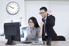 Happy business team with chart Royalty Free Stock Photos