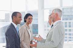Happy business team chatting. Together in the office Royalty Free Stock Image