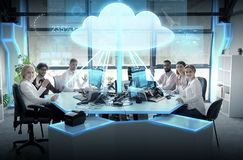 Happy business team with cloud computing hologram. Cloud computing, future technology and people concept - business team with computers waving hands at office Royalty Free Stock Photos