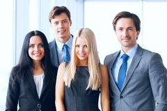 Happy business team. Of coworkers in office Stock Photo