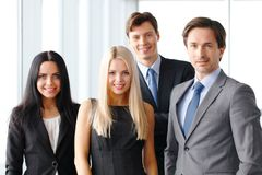 Happy business team. Of coworkers in office Stock Images
