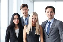 Happy business team. Of coworkers in office Royalty Free Stock Images