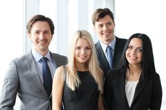 Happy business team. Of coworkers in office Royalty Free Stock Photo