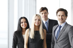 Happy business team. Of coworkers in office Stock Photography