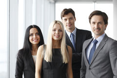 Happy business team. Of coworkers in office Stock Photos