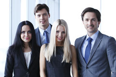 Happy business team. Of coworkers in office Royalty Free Stock Photography