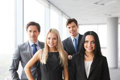 Happy business team. Of coworkers in office Stock Image