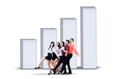 Happy business team and diagram Stock Photo