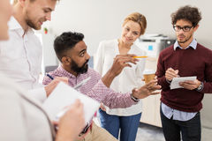 Happy business team discussing something at office Royalty Free Stock Photo
