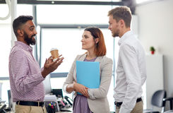 Happy business team drinking coffee at office Stock Images