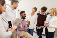 Happy business team drinking coffee at office Stock Photography
