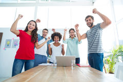 Happy business team with fists in the air Stock Image