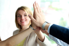 Happy business team giving high five in office Stock Images