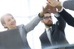 Happy business team giving high five in office Royalty Free Stock Image