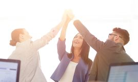 Successful businesswomen motivate each other with High Five. Happy business team giving high five in office royalty free stock photo