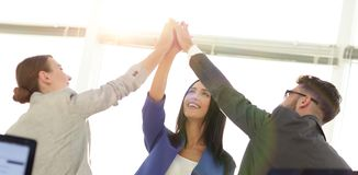 Successful businesswomen motivate each other with High Five. Happy business team giving high five in office royalty free stock images