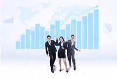Happy business team with growth graph. Happy successful business team with growth graph and world map background Royalty Free Stock Photography