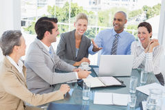 Happy business team having a meeting Stock Images