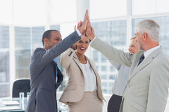Happy business team high fiving Royalty Free Stock Photography