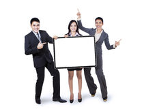 Happy business team holding billboard. Happy business team holding empty billboard isolated on white background Royalty Free Stock Photo
