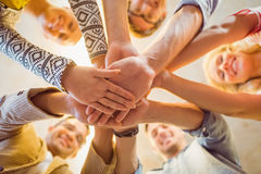 Happy business team joining their hands Royalty Free Stock Images