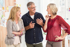 Happy business team laughing together Stock Images