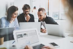 Happy business team making conversation at sunny meeting room.Horizontal.Blurred background. Happy business team making conversation at sunny meeting room Royalty Free Stock Photos