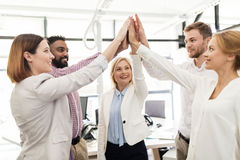 Happy business team making high five at office Royalty Free Stock Photography