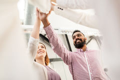 Happy business team making high five at office Stock Image