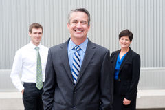 Happy business team at office. Happy business team at the office Royalty Free Stock Photos