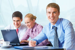 Happy business team at office. Happy successful business team working at office Stock Images