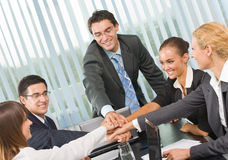 Happy business team at office. Happy successful gesturing business team at office Stock Image