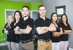 Happy business team at the office. A Happy business team at the office Royalty Free Stock Photography
