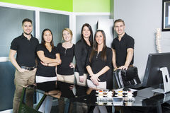 Happy business team at the office. A Happy business team at the office Royalty Free Stock Photos