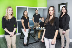 Happy business team at the office. A Happy business team at the office Stock Photography