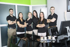 Happy business team at the office. A Happy business team at the office Royalty Free Stock Images