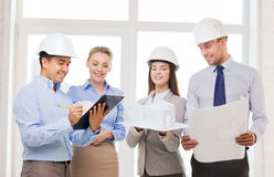 Happy business team in office. Business, architecture and office concept - happy team of architects in office Stock Images