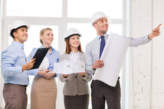 Happy business team in office. Business, architecture and office concept - happy team of architects in office Royalty Free Stock Image