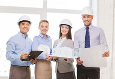 Happy business team in office. Business, architecture and office concept - happy team of architects in office Stock Photography