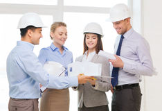Happy business team in office. Business, architecture and office concept - happy team of architects in office Royalty Free Stock Images