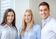 Happy business team in office. Business and office concept - happy business team in office Stock Photography