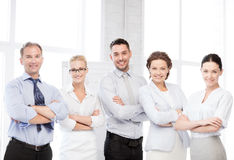 Happy business team in office. Business concept - picture of happy business team in office Stock Photo