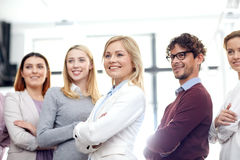 Happy business team in office. Corporate, teamwork and peope concept - happy business team in office Stock Image