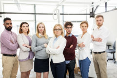 Happy business team in office. Corporate, teamwork and people concept - happy business team in office Stock Image