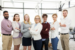 Happy business team in office. Corporate, teamwork and people concept - happy business team in office Royalty Free Stock Photos