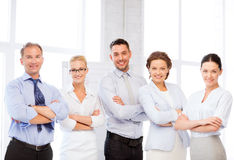 Happy business team in office. Picture of happy business team in office Royalty Free Stock Photos