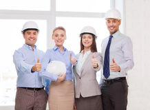 Happy business team in office showing thumbs up. Business, architecture and office concept - happy team of architects in office showing thumbs up Royalty Free Stock Image