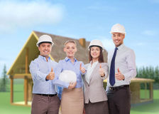 Happy business team in office showing thumbs up. Business, architecture and office concept - happy team of architects in office showing thumbs up Royalty Free Stock Images