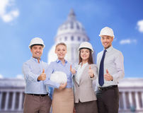 Happy business team in office showing thumbs up. Business, architecture and office concept - happy team of architects in office showing thumbs up Stock Image