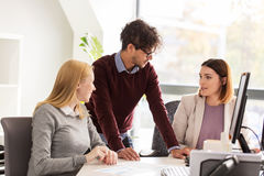 Happy business team with papers in office Stock Photo